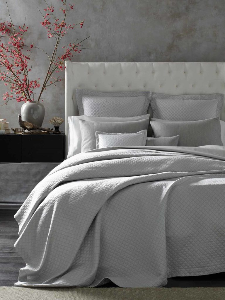 A sumptuous bed is layered with multiple textures;