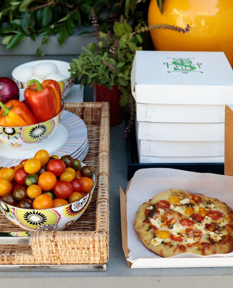 Pizza and vegetables on table