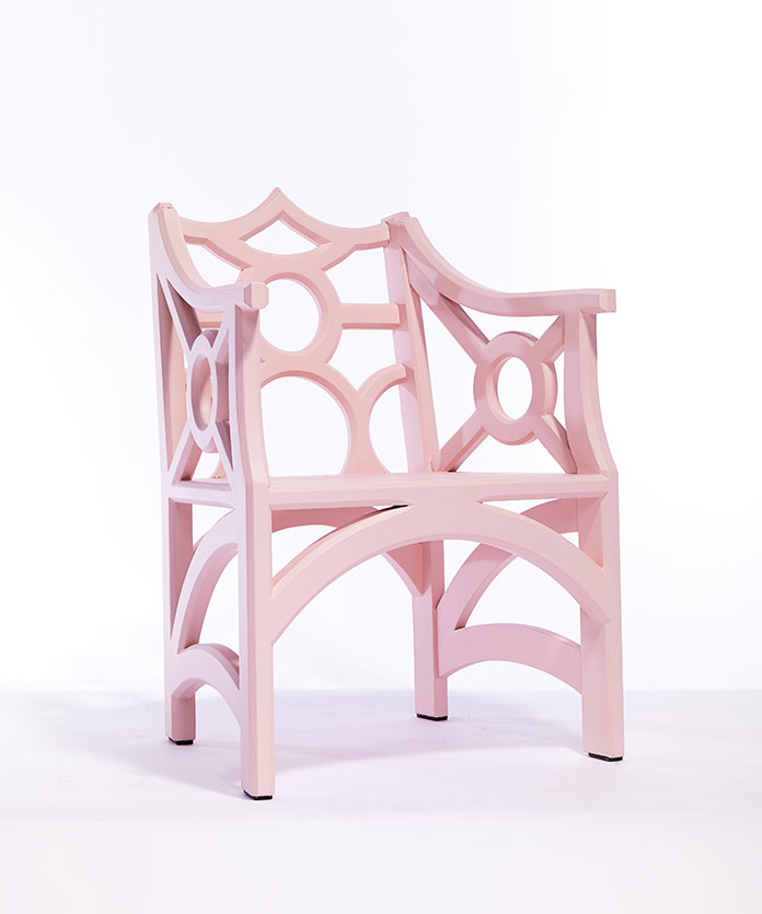 A pink outdoor chair designd by Munder-Skiles