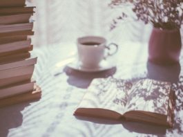 Book on table with coffee